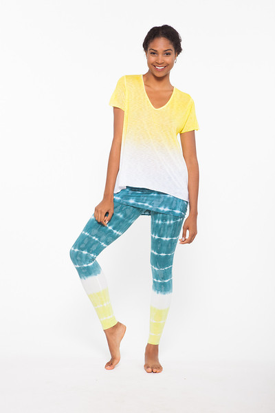 Top: Dynamic Tee Half Full in Lemon Drop, Bottom: Nomad Legging Bold Stripes in Blue Hawaii